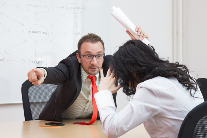 Male boss is not satisfied with the working results of his female colleague. He is showing her the door which means that she is fired. Female is expressing stress due to job loss.